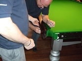 Picture showing cushions being refitted following a snooker table recovering.
